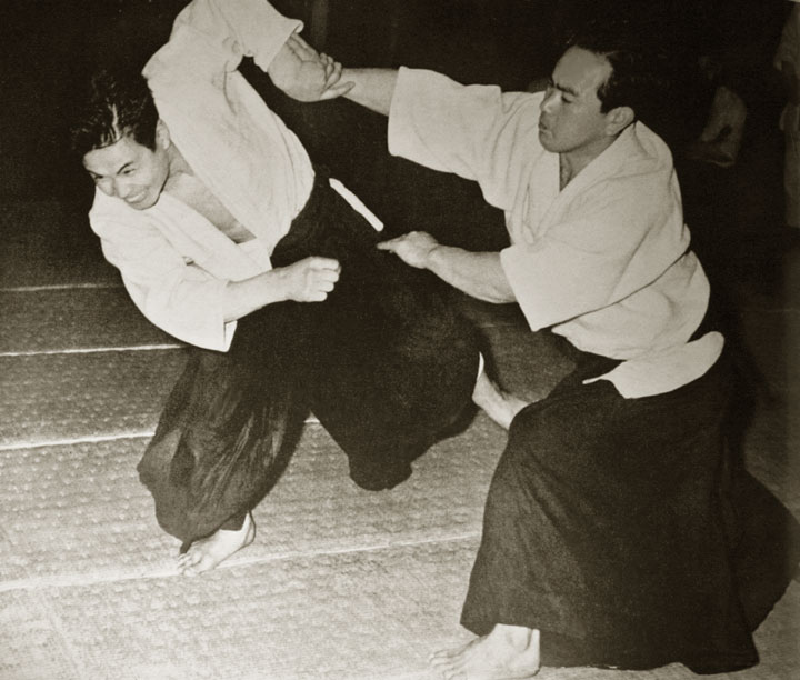 Koichi Tohei executing a dynamic throw c. 1960. Uke: Nobuyoshi Tamura