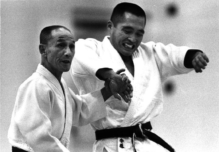 Shioda demonstrating with a young Tsuneo Ando Sensei