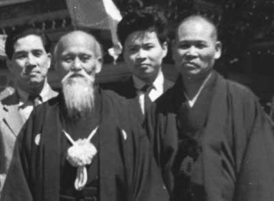 Morihei Ueshiba with his nephew Yoichiro (Noriaki) Inoue c. 1962. Nobuyoshi Tamura is standing in the center.