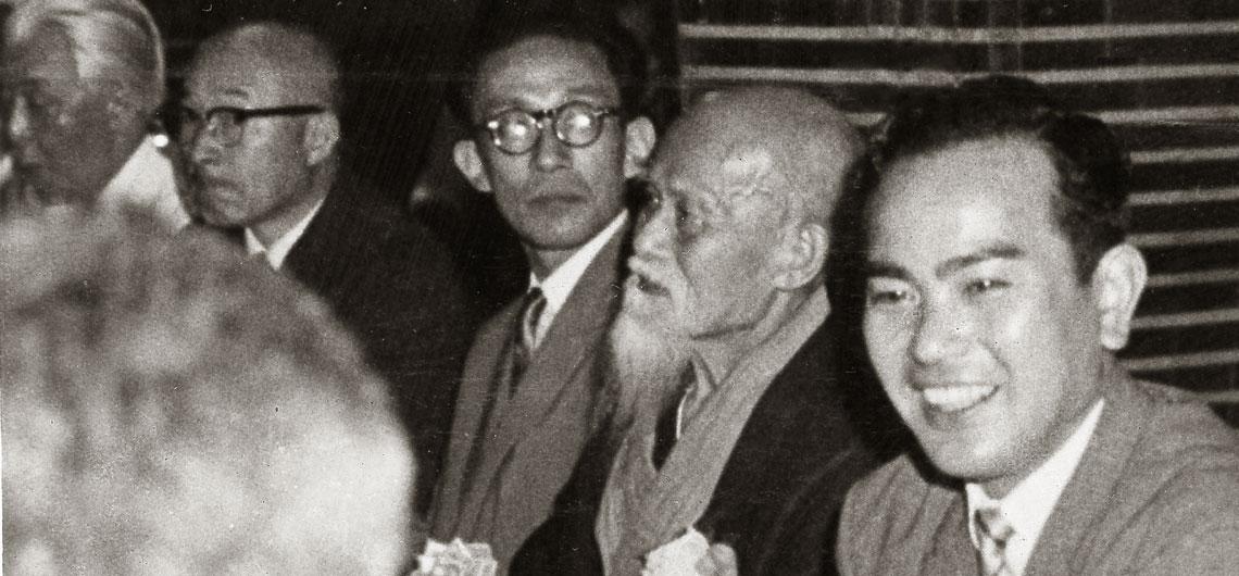 Kisshomaru Ueshiba, Morihei Ueshiba O-Sensei, and Koichi Tohei at a party c. 1960