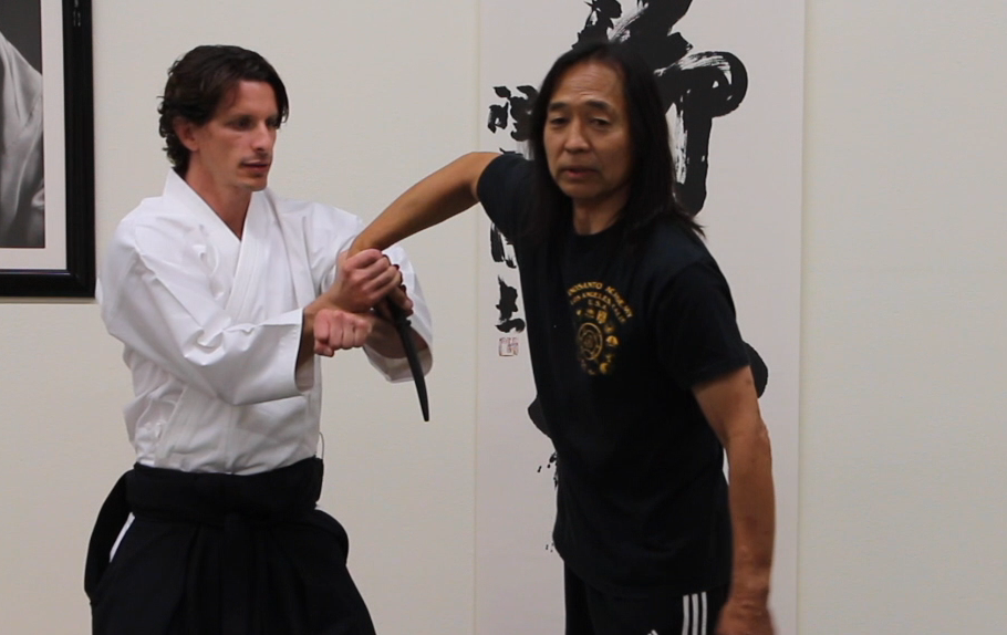 Josh gets to a successful disarm position after using hand movements to clear two prior attacks.