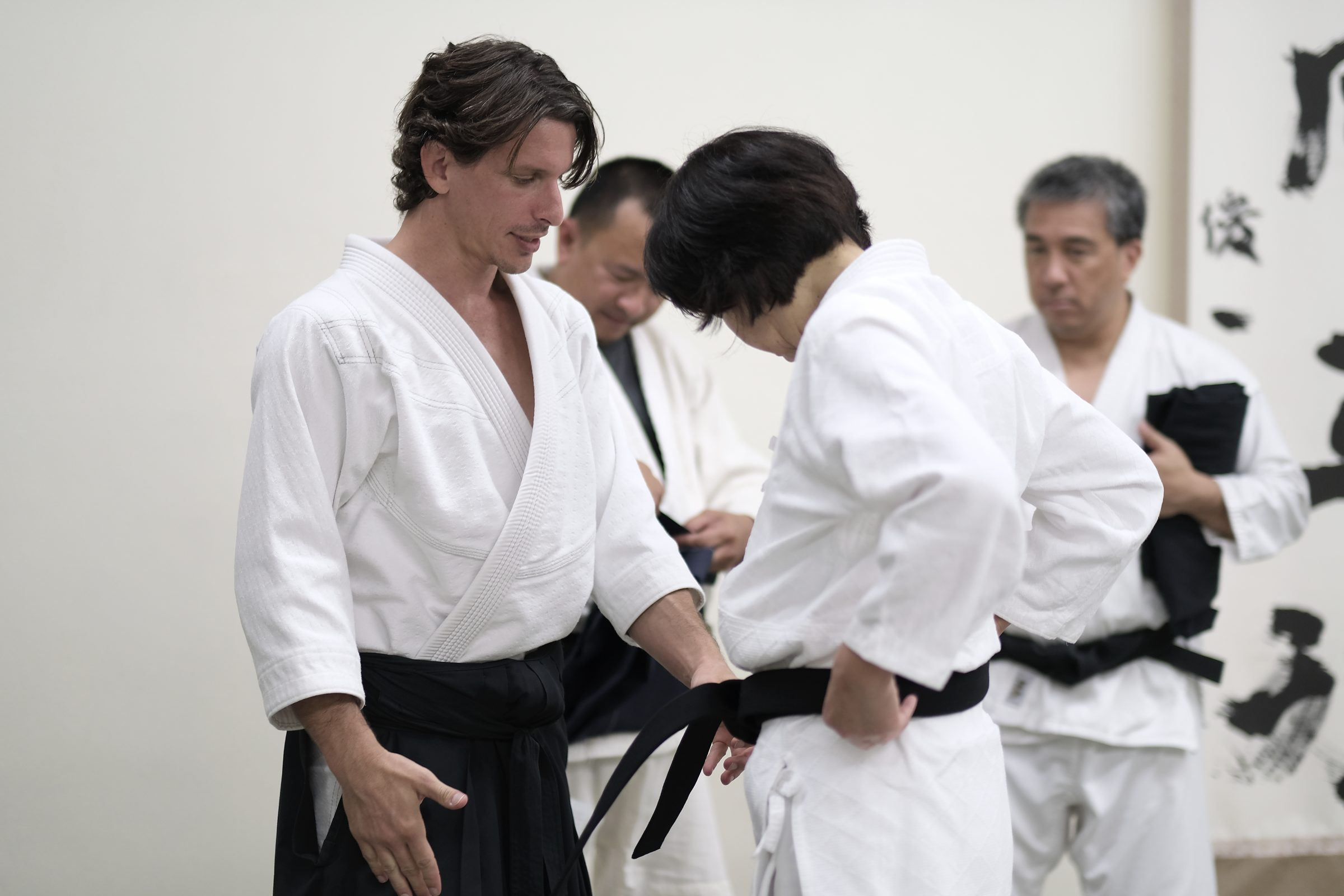 a4e0f71eb9 Josh Gold giving Mitsuko Nagayama her black belt after receiving her shodan  from Haruo Matsuoka.
