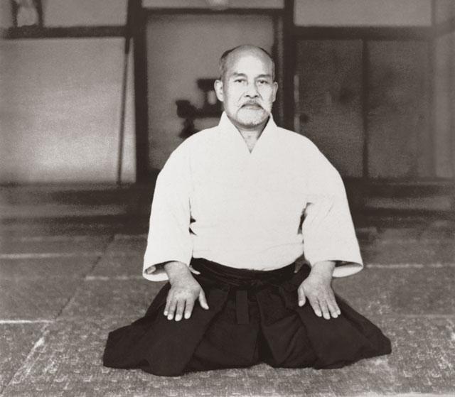 Formal portrait of Aikido Founder Morihei Ueshiba taken inside the Kobukan Dojo c. 1935