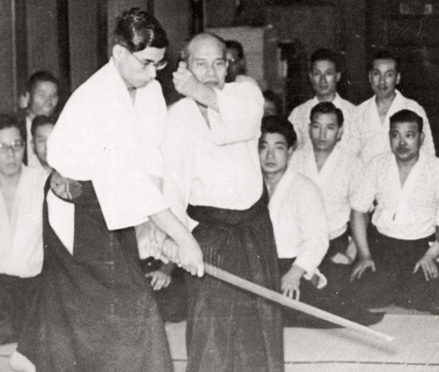 Morihei Ueshiba's adopted son, Kiyoshi Nakakura, attacking the Founder in demonstration, probably in Osaka c. 1934