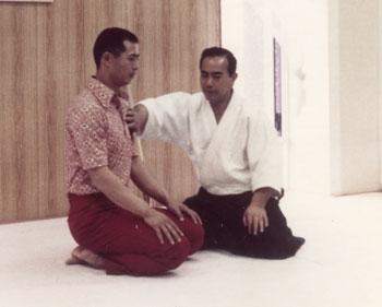 Koichi Tohei teaching ki principles to famous home run hitter Sadaharu Oh in the 1970s