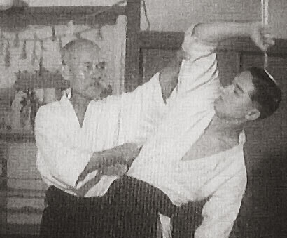 O-Sensei initiating shomenuchi while executing atemi. Uke: Gozo Shioda